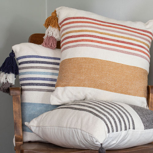 three cozy colorful pillows