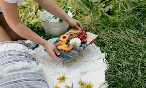 girl having a picnic at the park
