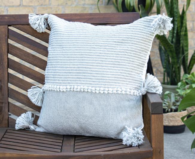 blue outdoor pillows in a wooden box