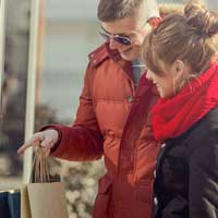 Couple viewing valentine's gifts through store window