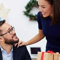 Woman gifting an employee a personalized corporate gift