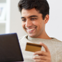 Man online shopping with credit card