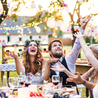 Couple celebrating with confetti during wedding reception