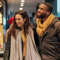 Couple window shopping during holiday season