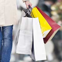 Man with multiple shopping bags during holiday season