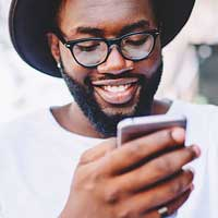 Man browsing through Twitter on cellphone